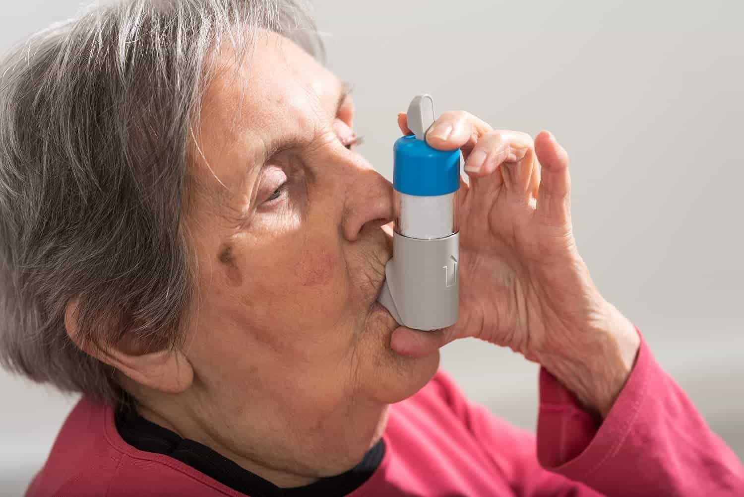 Patient taking inhaler hopsital ward