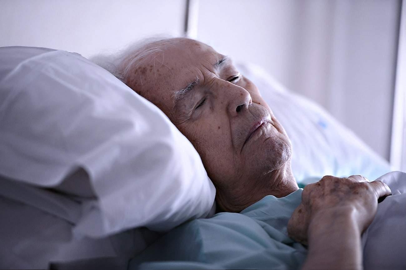 elderly man in bed