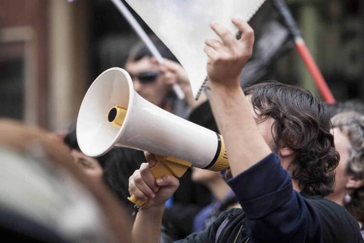 demostrator with megaphone and notebook protesting