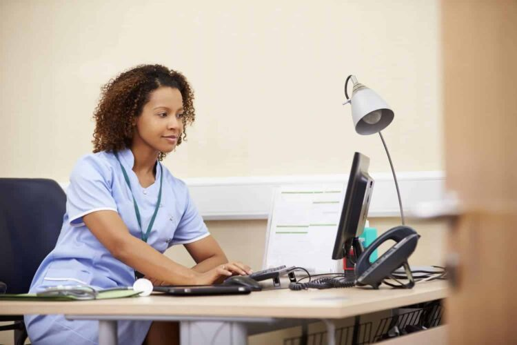 nurse working at desk in office