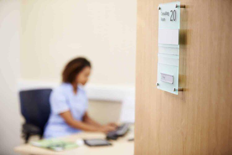 nurse working at desk