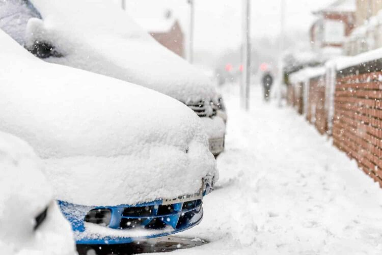 Day view parked cars under heavy snow