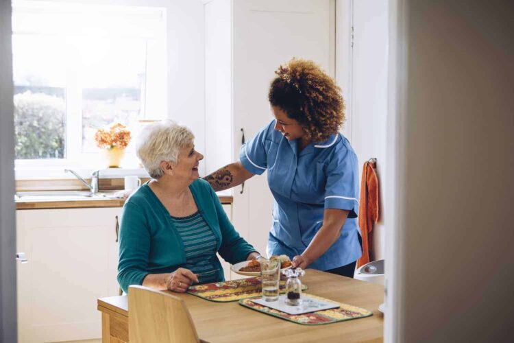 Care worker helping with meals