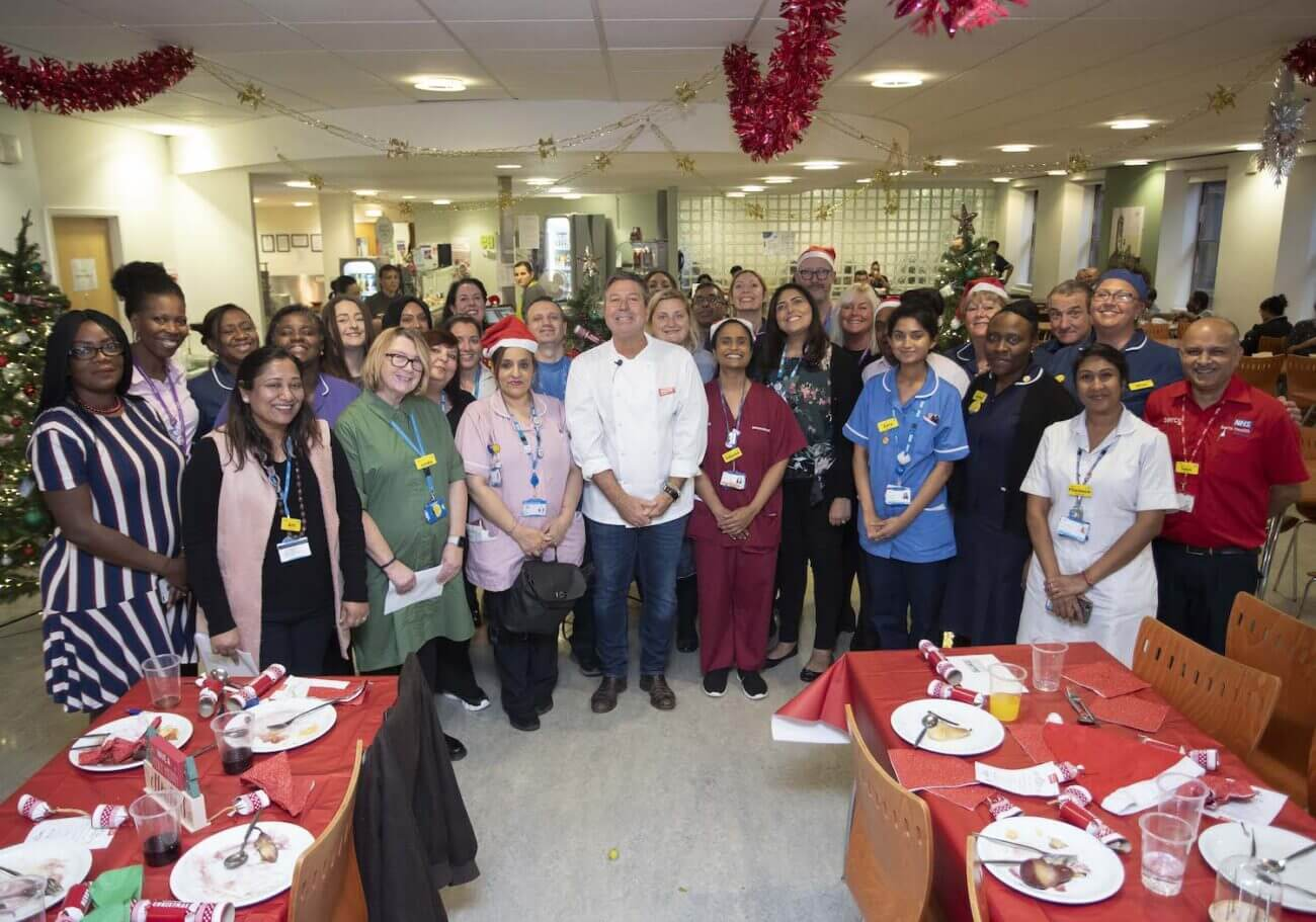 John Torode with NHS staff working over christmas - One4all Gift Cards